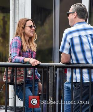 Mel C - Mel C relaxes at the Isle of Wight Festival with a pint at Isle of Wight Festival...