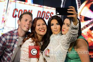 Kim Kardashian wax figure - Madame Tussauds London today revealed the very first 'selfie taking' wax figure of the Queen...