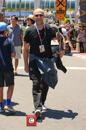 Michael Rooker - Actor Michael Rooker walking through the crowds of Comic-Con carrying a Spider-Man skateboard deck - San Diego,...