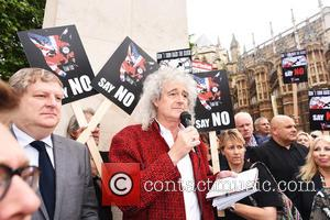 Brian May Leads Badger Funeral March Through London