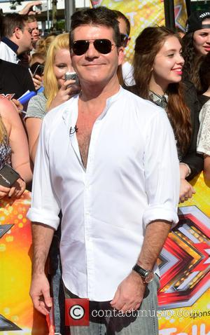 Has Simon Cowell Hinted One Direction Could Be About To Take A Break Following Louis' Baby News?