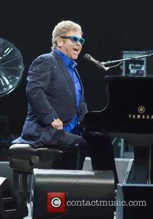 Elton John Accepts Apology From Designers Over Ivf Baby Row