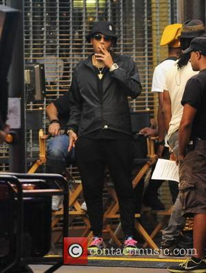 Chris Brown - Singer Chris Brown hops out of a sports car on the set of his new music video...