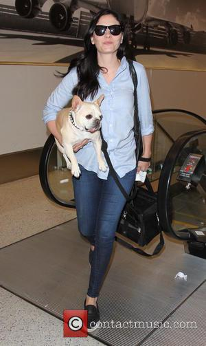 Jodi Lyn O'Keefe - 'Vampire Diaries' star Jodi Lyn O'Keefe departs from Los Angeles International Airport (LAX) with her pet...