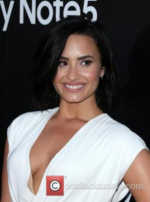 Demi Lovato Recruits Celebrity Friends To Unveil Album Tracks On Twitter