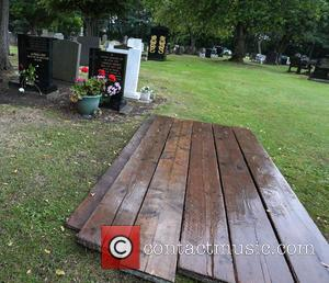 View - The gravestone of Cilla Black's parents and her freshly dug grave, covered with planks, in Allerton Cemetery at...
