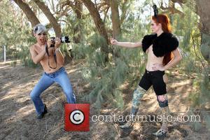 Phoebe Price , Sham Ibrahim - Phoebe Price and friend Sham Ibrahim pose during a photoshoot for an XPOZ Jeans...