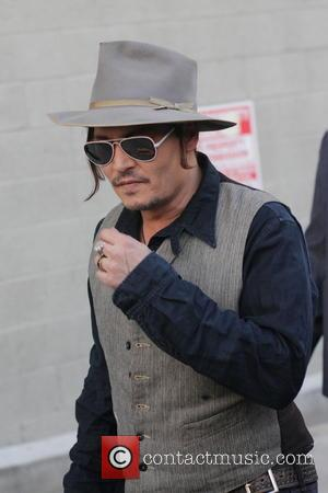 Johnny Depp - Johnny Depp comes over to greet fans as he departs his appearance on Jimmy Kimmel Live! at...