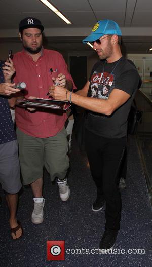 Chris Martin - Chris Martin at Los Angeles International Airport (LAX) - Los Angeles, California, United States - Friday 18th...