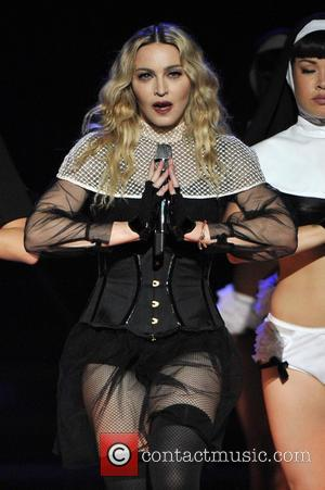 Madonna's Daughter Allegedly Caught Drinking At Concert