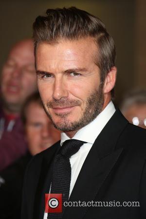 David Beckham Shows Off His Latest Tattoo