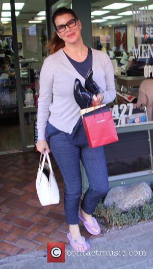 Milla Jovovich - Milla Jovovich leaves a nail salon at beverly hills - Los Angeles, California, United States - Thursday...
