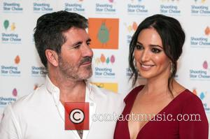 Simon Cowell , Lauren Silverman - The Shooting Star Chase Ball held at the Dorchester - Arrivals - London, United...