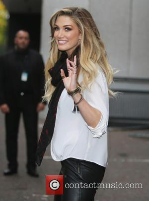 Delta Goodrem Cares For Kids On Scary Flight