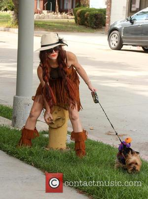 Phoebe Price - Phoebe Price wears a Pocahontas-like outfit while walking her dog Henry - Los Angeles, California, United States...