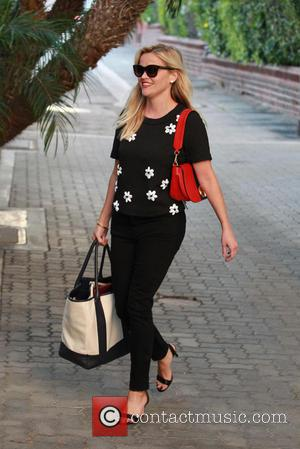 Reese Witherspoon - Reese Witherspoon is all smiles as she leaves an office building in Beverly Hills - Los Angeles,...