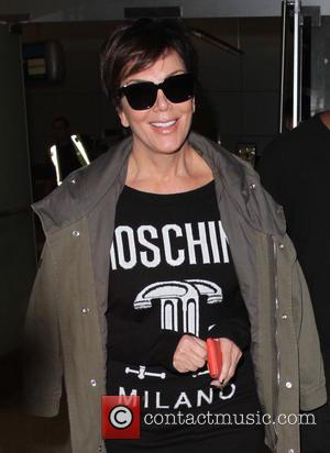 Kris Jenner - Kris Jenner and Corey Gamble arrive at Los Angeles International Airport (LAX) - Los Angeles, California, United...