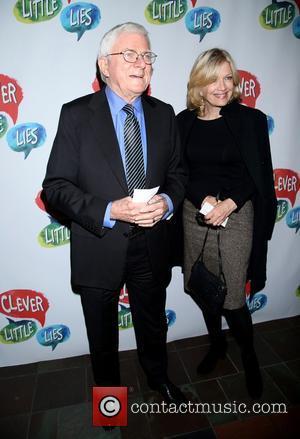 Phil Donahue and Diane Sawyer
