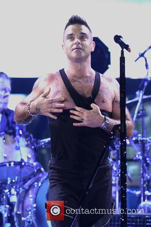 Robbie Williams Battling Injuries On Tour
