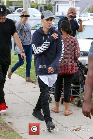 Justin Bieber - Justin Bieber spotted leaving a public restroom in Beverly Hills - Los Angeles, California, United States -...