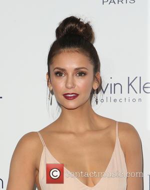 Nina Dobrev Dresses Up As Victoria Beckham