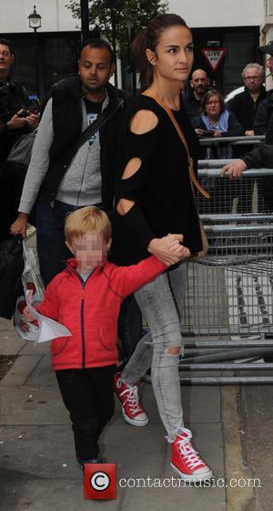 Natasha Shishmanian , Eli Alfred Michael Evans - Chris Evans and his wife Natasha Shishmanian with their sons outside the...