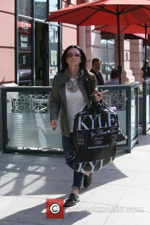 Kyle Richards - Kyle Richards seen leaving her clothing store carrying lots of bags. - Los Angeles, California, United States...