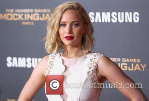 The Hunger Games Cast Show Support For France At Los Angeles Premiere