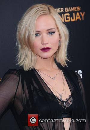 The Hunger Games Stars Down Whiskey Shots At Premiere
