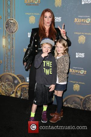 Poppy Montgomery's Stepson Won Risque Nude Book In Christmas Gift Swap