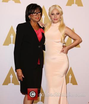 Cheryl Boone Isaacs and Lady Gaga