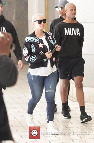 Amber Rose - Amber Rose goes shopping at the Beverly Center with a posse of men wearing 'MUVA' sweatshirts from...