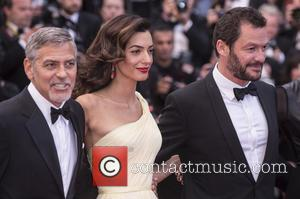 George Clooney, Amal Clooney and Domonic West