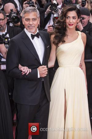 George And Amal Clooney 'Avoiding Danger Zones' During Her Pregnancy