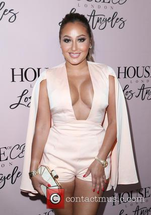 Adrienne Bailon - House Of CB Flagship Store Launch at House Of CB Store - West Hollywood, California, United States...