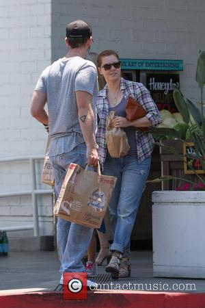 Amy Adams , Darren Le Gallo - Amy Adams and her husband with their daughter go shopping at Bristol Farms...