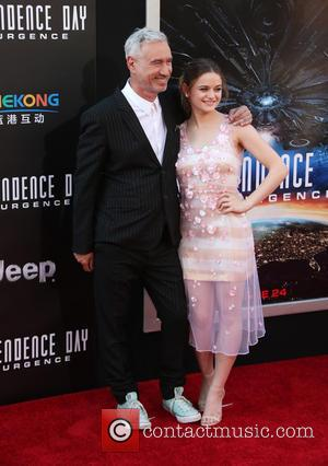 Roland Emmerich and Joey King
