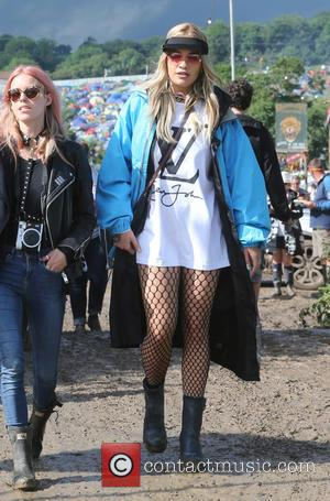 Rita Ora avoiding muddy puddles backstage on the first day at the 2016 Glastonbury Festival - Celebrity Sightings at Glastonbury...