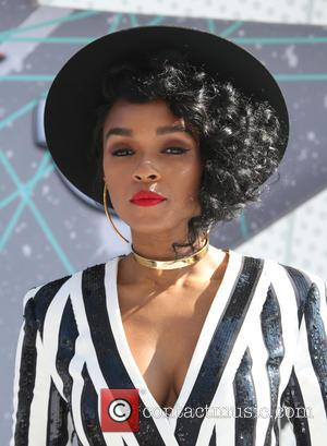Janelle Monae seen wearing a striking black and white sequinned playsuit at the at the 2016 BET Awards held at...