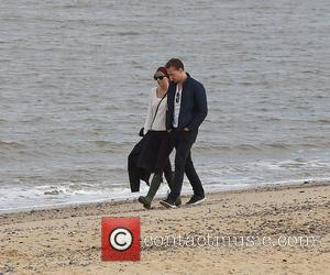 Taylor Swift and her latest beau Tom Hiddleston enjoy a romantic walk on the beach near Lowestoft in Suffolk, England....