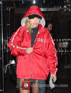 Singer Rita Ora pictured wearing a bright red hooded Dolce and Gabbana jacket as she steps out in London after...
