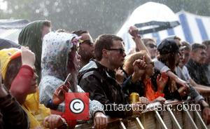 Wet crowds watch bands on the first day of Blissfields 2016 - Winchester, United Kingdom - Friday 1st July 2016