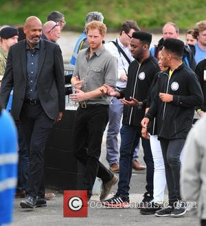 Prince Harry takes time to speak with crowds whilst visiting Wigan. The Prince was visiting the city to show his...