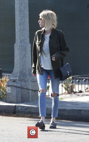 Emma Roberts dressed casually in a plain t-shirt and blue jeans whilst out shopping at Melrose Place in Beverly Hills....