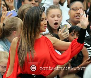 Nicole Scherzinger stopping to welcome the crowd at Wembley Arena for the The six chair challenge. London, United Kingdom -...