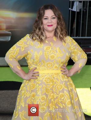 Actress Melissa McCarthy wearing a bright yellow mid-length dress at the premiere of the 2016 remake of Ghostbusters. The premiere...