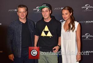 Matt Damon posing alone and with Kim Gloss and Alicia Vikander at the Jason Bourne Social Movie Night held at...