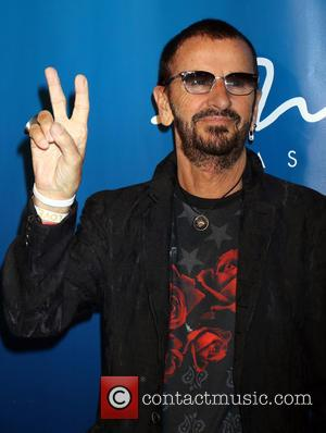 Ringo Starr posing alone and with Barbara Bach at the 10th anniversary of LOVE held at The LOVE Theater at...