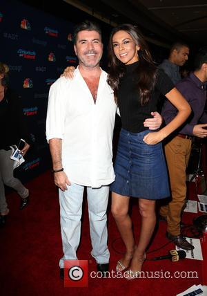 Simon Cowell seen posing alone and with Terri Seymour at NBC's 'America's Got Talent' season 11 live show held at...