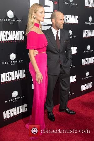 Rosie Huntington-Whiteley and her partner Jason Statham attending the premiere of Summit Entertainment's 'Mechanic 2: Resurrection' at ArcLight Hollywood in...